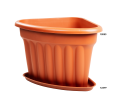 A Corner Planter Unit in Terracotta with a Base to Catch any Spills