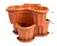 A Stacked Set of Large Planter for Six Plants in Terracotta with a Base to Catch any Spills