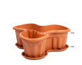A Large Planter for Three Plants in Terracotta with a Base to Catch any Spills