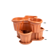 A Stacked Set of Medium Planter for Six Plants in Terracotta with a Base to Catch any Spills